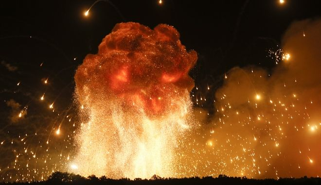 A powerful explosion is seen in the ammunition depot at a military base in Kalynivka, west of Kiev, Ukraine, early Wednesday, Sept. 27, 2017.  Ukrainian officials say they have evacuated more than 30,000 people after a fire and ammunition explosions, at the military base. (AP Photo/Efrem Lukatsky)