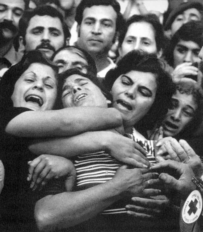 Greek Cypriot women cry in anguish at Nicosia, Cyprus on Monday, Oct. 28, 1974, after waiting in vain to see their missing loved ones among the final group of released prisoners of war. Two hundred and fifty-one Greek and 267 Turkish Cypriot prisoners were exchanged at the green line which divides the respective sectors of Nicosia. (AP Photo)