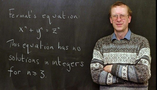 Princeton University mathematics professor Andrew John Wiles poses next to