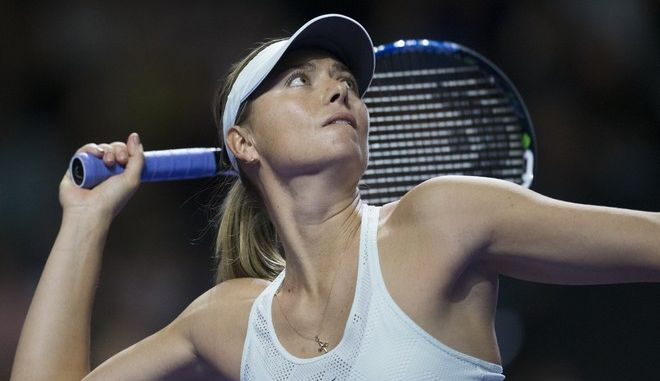 Russia's Maria Sharapova plays a return during the first round match against Slovakia's Magdalena Rybarikova at the Kremlin Cup tennis tournament in Moscow, Russia, Tuesday, Oct. 17, 2017. Maria Sharapova was beaten by Magdalena Rybarikova in the first round of the Kremlin Cup on Tuesday, ending her bid for a second title in two weeks. (AP Photo/Alexander Zemlianichenko)