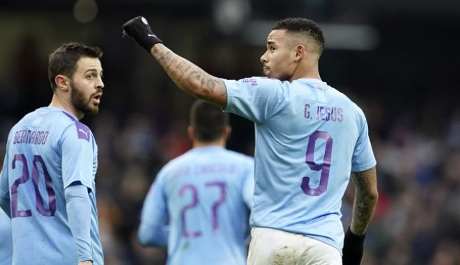 Manchester City's Gabriel Jesus celebrates with Bernardo Silva, left, after scoring his side's third goal during an English FA Cup fourth round soccer match between Manchester City and Fulham at the Etihad Stadium in Manchester, England, Sunday, Jan. 26, 2020. (AP Photo/Jon Super)