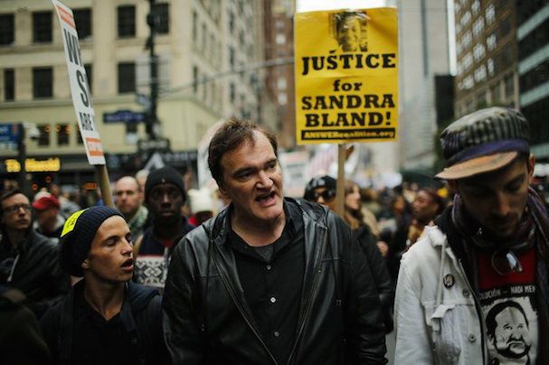 US film director Quentin Tarantino (C) takes part in a march against police brutality called