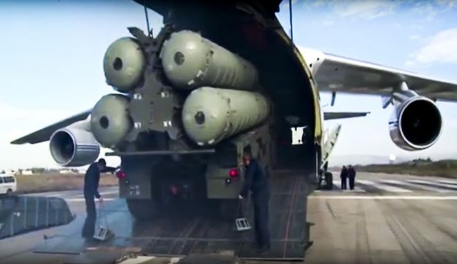 This photo made from the footage taken from Russian Defense Ministry official web site on Friday, Nov. 27, 2015, shows a Russian S-400 air defense missile systems being unloaded from an An-124 Ruslan cargo plane at the Hemeimeem air base in Syria, about 50 kilometers (30 miles) south of the border with Turkey. Russias President Vladimir Putin has ordered the deployment of the S-400s to the Russian base in Syria to help protect Russian warplanes after Turkey downed a Russian military jet at the border with Syria on Tuesday. (Russian Defense Ministry Press Service pool photo via AP)
