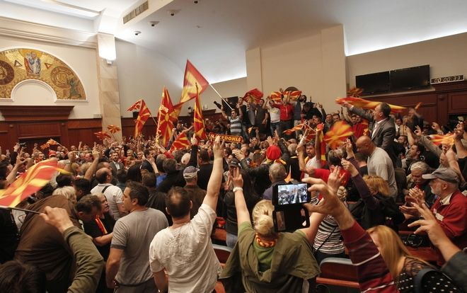 Protestors shout after entering into the parliament building in Skopje, Macedonia, Thursday, April 27, 2017. Scores of protesters have broken through a police cordon and entered Macedonian parliament to protest the election of a new speaker despite a months-long deadlock in talks to form a new government. (AP Photo/Boris Grdanoski)