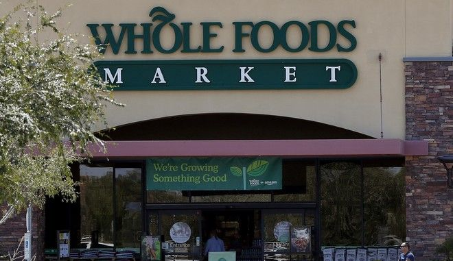 Shoppers come and go from Whole Foods Market grocery store, Monday, Aug. 28, 2017 in Chandler, Ariz. Amazon is moving swiftly to make big changes at Whole Foods, saying it plans to cut prices on avocados, bananas, eggs, salmon, beef and more. Amazon has completed its $13.7 billion takeover of organic grocer Whole Foods, and the e-commerce giant is wasting no time putting its stamp on the company. (AP Photo/Matt York)