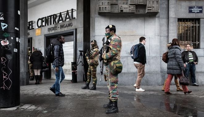 Belgian Army soldiers patrol outside the Central Station in Brussels on Wednesday, March 23, 2016. Belgian authorities were searching Wednesday for a top suspect in the country's deadliest attacks in decades, as the European Union's capital awoke under guard and with limited public transport after 34 were killed in bombings on the Brussels airport and a subway station. (AP Photo/Valentin Bianchi)