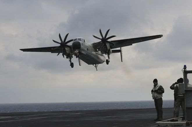A U.S. Navy C-2 Greyhound approaches the deck of the Nimitz-class aircraft carrier USS Carl Vinson during the annual joint military exercise called Foal Eagle between South Korea and the United States at an unidentified location in the international waters, east of the Korean Peninsula, Tuesday, March 14, 2017. (AP Photo/Lee Jin-man)