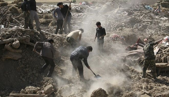 In this Sunday, Aug. 12, 2012 photo, Iranians search the ruins of buildings after Saturday's earthquake in a village near the city of Varzaqan in northwestern Iran. Over 300 people have died from Saturday's twin earthquakes in Iran's East Azerbaijan province. Iran is located on seismic fault lines, is prone to earthquakes and it experiences at least one earthquake every day on average, although the vast majority are so small they go unnoticed. (AP Photo/Ali Hamed Haghdoust, Mehr News Agency)