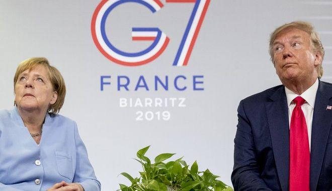 Άνγκελα Μέρκελ και Ντόναλντ Τραμπ σε σύνοδο G7 στην Γαλλία, Αύγουστος 2019