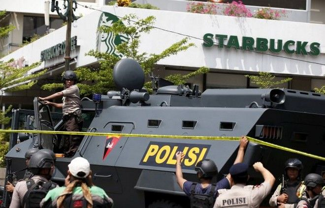 A police armoured personnel carrier is seen parked near the scene of an attack in central Jakarta January 14, 2016. Militants launched a gun and bomb assault in the center of the Indonesian capital on Thursday, killing at least six people, in an attack that followed a threat by Islamic State fighters to put the country in their