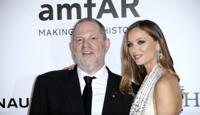 Producer Harvey Weinstein and stylist Georgina Chapman pose for photographers upon arrival for the amfAR Cinema Against AIDS benefit at the Hotel du Cap-Eden-Roc, during the 69th Cannes international film festival, Cap d'Antibes, southern France, Thursday, May 19, 2016. (AP Photo/Joel Ryan)