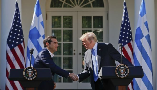 President Donald Trump and Greek Prime Minister Alexis Tsipras shake hands during their news conference in the Rose Garden of the White House in Washington, Tuesday, Oct. 17, 2017. (AP Photo/Pablo Martinez Monsivais)