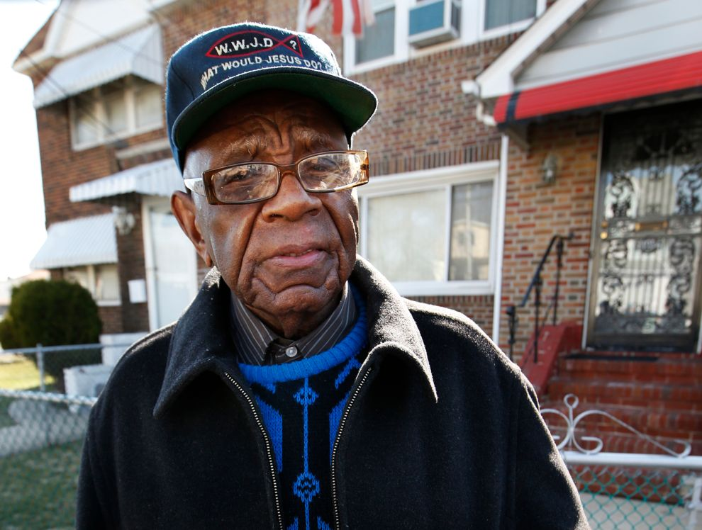 William Jordan, 92, speaks to reporters Thursday, April 2, 2015, outside his home in the Queens borough of New York. Jordan lives across the street from a house where Noelle Velentzas, 28, lives. Veletzas is one of two women arrested early Thursday on charges linked to terrorism,according to court papers. Prosecutors said the two women were plotting to build a bomb to be used in a Boston Marathon-type attack.