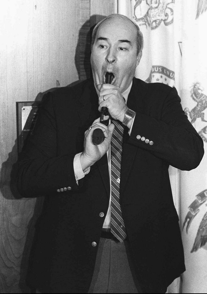 Pennsylvania state Treasurer R. Budd Dwyer points a pistol into his mouth as he prepares to pull the trigger killing himself in front of news cameras during a news conference in his State Capitol office in Harrisburg, Jan. 22, 1987. He was to be sentenced in federal court on a bribery conviction later that week. (AP Photo/Paul Vathis)