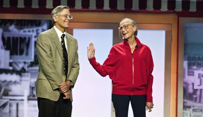 Jim Walton, left, and Alice Walton, right, children of the late Walmart Stores Inc. founder Sam Walton, reminisce about working for their father during the Walmart shareholders' meeting in Fayetteville, Ark., Friday, June 1, 2012. (AP Photo/April L. Brown)