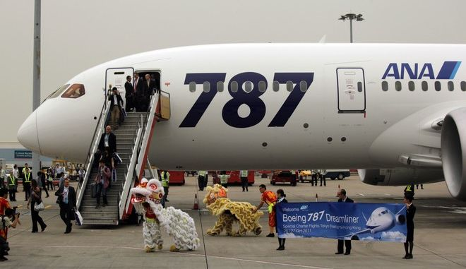 Passengers of an All Nippon Airways Boeing 787 are welcomed by lion dance to celebrate the airplane's inaugural commercial flight from Japan, at Hong Kong International Airport on Wednesday, Oct. 26, 2011. The jet, nicknamed The Dreamliner by Boeing Corp., was flown by Japan's All Nippon Airways and was packed with aviation reporters and enthusiasts  some of whom paid thousands of dollars for the privilege. (AP Photo/Vincent Yu)