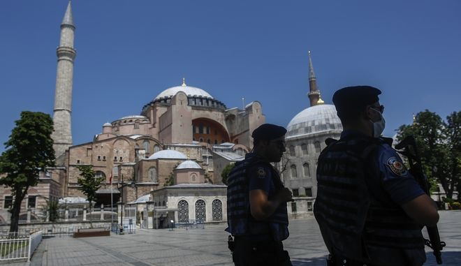Armed police patrol outside the Byzantine-era Hagia Sophia, one of Istanbul's main tourist attractions in the historic Sultanahmet district of Istanbul, Thursday, June 25, 2020. Turkey's highest administrative court on Thursday July 2, 2020, began considering a request for the UNESCO World Heritage site that now serves as a museum be reverted back into a mosque. (AP Photo/Emrah Gurel)
