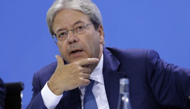 Italian Prime Minister Paolo Gentiloni speaks during a press conference after a gathering of European leaders on the upcoming G-20 summit in the chancellery in Berlin, Germany, Thursday, June 29, 2017. (AP Photo/Markus Schreiber)