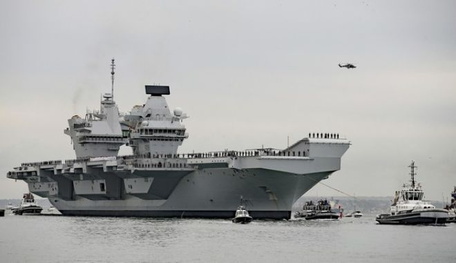 FILE - In this Aug. 16, 2017 file photo, a view of aircraft carrier HMS Queen Elizabeth. The British navys newest and most expensive aircraft carrier needs repairs after a faulty shaft seal was identified during sea trials, it was reported on Tuesday, Dec. 19, 2017. (Steve Parsons/PA via AP, File)