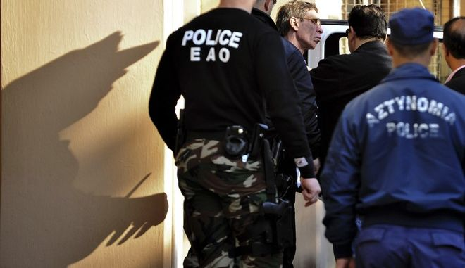 """Cyprus police officers escort Egyptian Seif Eddin Mustafa, third left, who hijacked an EgyptAir jetliner Tuesday to a court for a remand hearing as authorities investigate him on charges including hijacking, illegal possession of explosives and abduction in the Cypriot coastal town of Larnaca Wednesday, March 30, 2016. The man described as """"psychologically unstable"""" hijacked a flight Tuesday from Egypt to Cyprus and threatened to blow it up. His explosives turned out to be fake, and he surrendered with all passengers released unharmed after a bizarre six-hour standoff. (AP Photo)"""