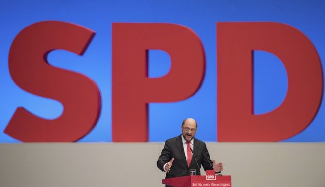 SPD leader and top candidate for the German elections in September, Martin Schulz, speaks during a meeting of Germany's Social Democratic Party in Dortmund, Germany, Sunday, June 25, 2017. (Guido Kirchner/dpa via AP)