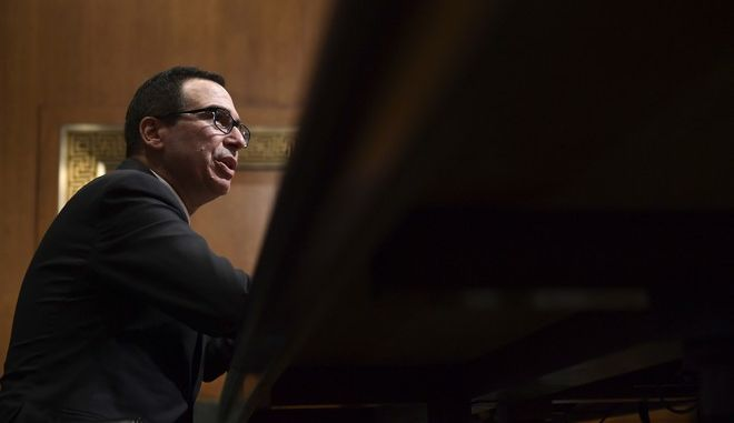 Treasury Secretary Steven Mnuchin testifies before the Senate Finance Committee on Capitol Hill in Washington, Wednesday, Feb. 14, 2018, on President Donald Trump's fiscal year 2019 budget proposal. (AP Photo/Susan Walsh)