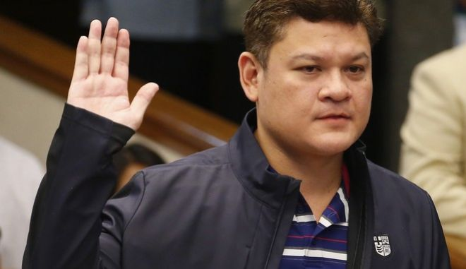 "Paolo Duterte, the eldest son of President Rodrigo Duterte takes his oath in the continuing senate probe on the more than half a ton of the illegal drug methamphetamine hydrochloride, locally known as ""Shabu"" worth $128 million (P6.4 Billion Pesos) from China which passed through customs from China Thursday, Sept. 7, 2017, in Pasay city, southeast of Manila, Philippines. (AP Photo/Bullit Marquez)"