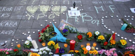 Floral tributes, candles and chalked messages of condolence sit on Beursplein square in Brussels, Belgium, on Tuesday, March 22, 2016. Explosions ripped through the Brussels airport departure hall and a downtown subway station on Tuesday morning, causing deaths and injuries and spurring fears of imminent follow-up attacks in the capital of the European Union. Photographer: Jasper Juinen/Bloomberg via Getty Images