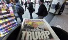 The New York Post newspaper featuring president-elect Donald Trump's victory is displayed at a newsstand, Wednesday, Nov. 9, 2016 in New York. Donald Trump claimed his place Wednesday as America's 45th president, an astonishing victory for the celebrity businessman and political novice who capitalized on voters' economic anxieties, took advantage of racial tensions and overcame a string of sexual assault allegations on his way to the White House. (AP Photo/Mark Lennihan)