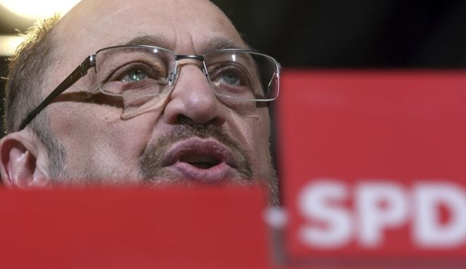 Martin Schulz, chairman of the German Social Democrats, SPD, addresses the media during a news conference in Berlin, Germany, Friday, Dec. 15, 2017. Leaders of Germany's center-left Social Democrats have agreed to enter exploratory talks on a new government led by Chancellor Angela Merkel. (AP Photo/Michael Sohn)