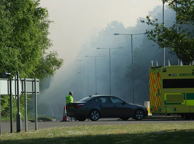 SEALED OFRFR: Roads in the surrounding areas have been seakled off as smoke rises from the blazing Swinley Forest in Forresters Way, Bracknell, Berkshire (west of London)  UK.