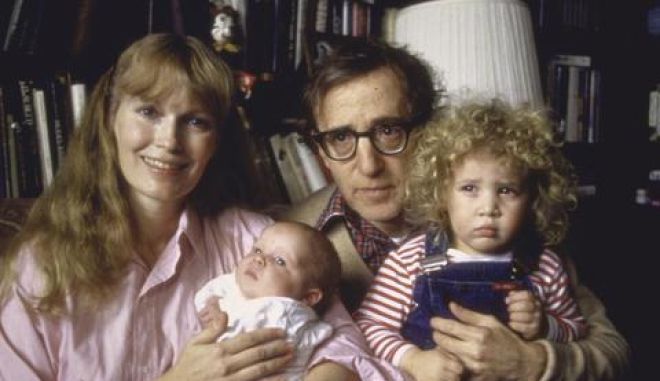 Actress Mia Farrow smiling with longtime companion actor/director Woody Allen holding their newborn son Satchel while adopted daughter Dylan sits on Allen's lap.  (Photo by David Mcgough//Time Life Pictures/Getty Images)