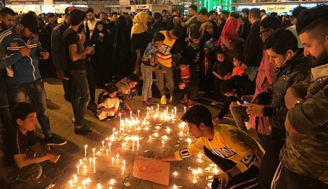 Κεριά στη Μοσούλη στη μνήμη των θυμάτων του ναυαγίου