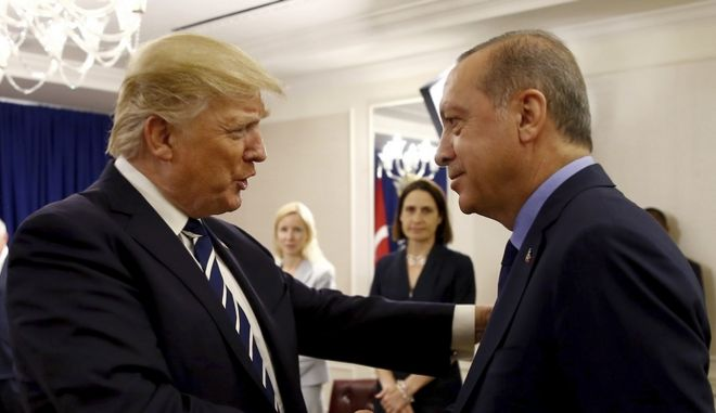 Turkey's President Recep Tayyip Erdogan, right, and US President Donald Trump shake hands prior to their meeting in New York, Thursday, Sept. 21, 2017. Erdogan is in New York for the United Nations General Assembly. (Pool Photo via AP)
