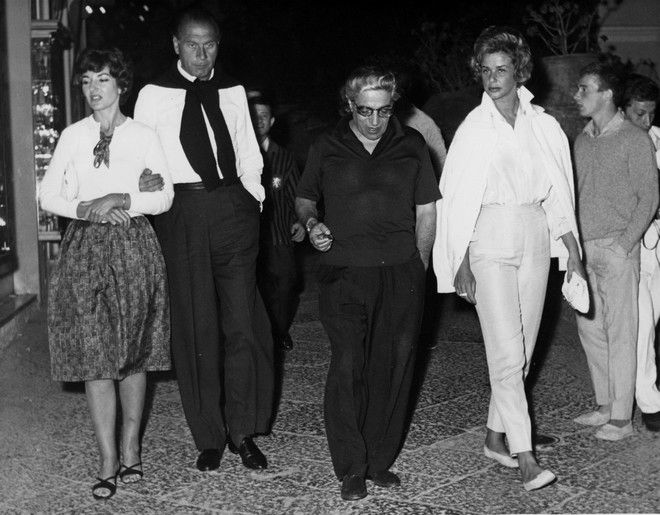 Star soprano Maria Callas, left, locks arms with Italian Prince Gaetano Parente next to Aristotle Onassis and Italian Princess Doris Pignatelli, right as they walk out from a night club in Capri, Italy, in the early hours of August 1, 1961. Onasis and Miss Callas arrived on the ship owners yacht