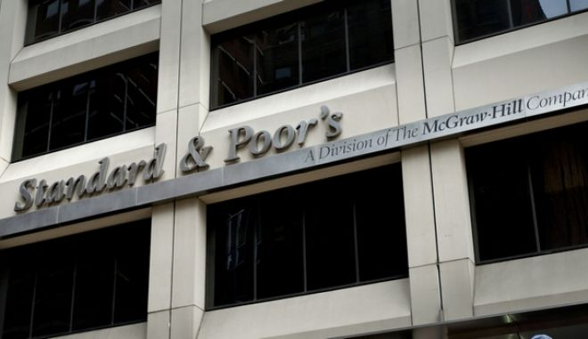 FILE - In this Aug. 6, 2011 photo, tourists drive past Standard & Poor's headquarters in New York's financial district Saturday, Aug. 6, 2011. (AP Photo/Karly Domb Sadof, File)