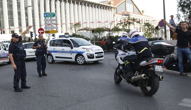 French police officers cordon off the area outside Marseille 's main train station Sunday, Oct. 1, 2017 in Marseille, southern France. A man with a knife attacked people at the main train station in Marseille on Sunday, killing one person before soldiers shot dead the assailant, officials said. (AP Photo/Claude Paris)