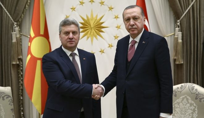 Turkey's President Recep Tayyip Erdogan, right, shakes hands with Gjorge Ivanov, left, President of the Former Yugoslav Republic of Macedonia, prior to their meeting in Ankara, Turkey, Tuesday, Feb. 20, 2018. Ivanov is in Turkey for an official visit. (Kayhan Ozer/Pool Photo via AP)