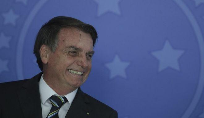 Ο Βραζιλιάνος πρόεδρος Ζαΐχ Μπολσονάρο σε εκδήλωση στο προεδρικό μέγαρο στην Μπραζίλια