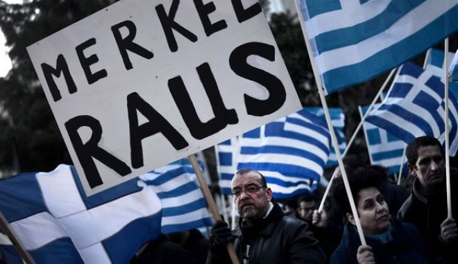 "Some of about 1,000 members of the ultra-nationalist Golden Dawn party demonstrate on March 22, 2013 outside the German Embassy in Athens against the EU austerity plans for Cyprus. Germany's Finance Minister Wolfgang Schaeuble said on March 22 that the crisis in debt-hit Cyprus has so far not weighed on its other southern partners as financial markets see the eurozone is better equipped. Placard reads in German: ""Merkel Out"".     AFP PHOTO / ARIS MESSINIS"