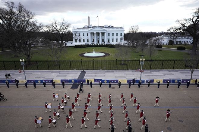 A ceremonial honor guard marches past the White House as they rehearse for the President-elect Joe Biden's inauguration ceremony, Monday, Jan. 18, 2021, in Washington. (AP Photo/David Phillip)1