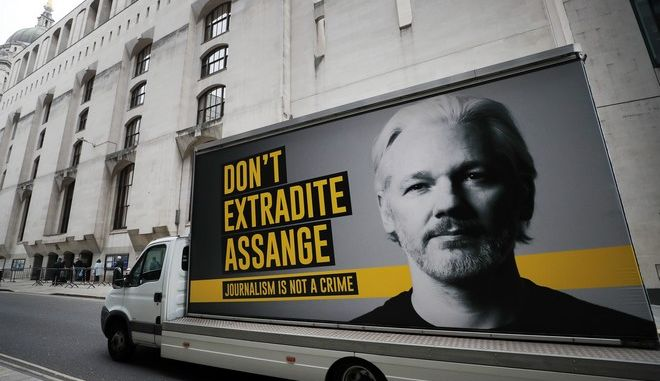 A lorry with a billboard of Julian Assange arrives at the Old Bailey court in London, Monday, Sept. 21, 2020 as the Julian Assange extradition hearing to the US continues. (AP Photo/Frank Augstein)