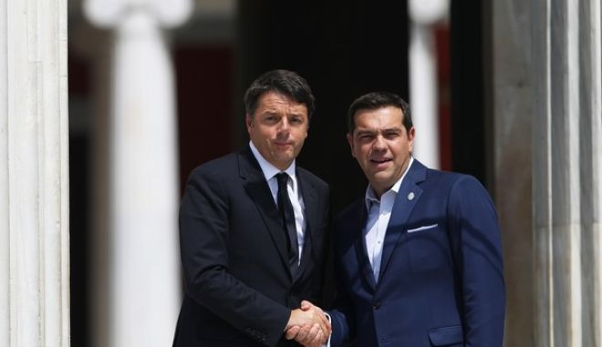 Greek Prime Minister Alexis Tsipras, right, welcomes his Italian counterpart Matteo Renzi during a Mediterranean Leaders' summit in Athens, on Friday, Sept, 9, 2016. (AP Photo/Petros Giannakouris)