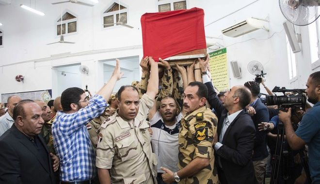 Men carry the coffin of a soldier, who was killed a day earlier in the restive Sinai Peninsula, during a funeral ceremony in the 10th of Ramadan city, about 60 kms north of Cairo, on Saturday, July 8, 2017.  The Islamic State group claimed responsibility for attacking a remote Egyptian army outpost in the Sinai Peninsula with a suicide car bomb and heavy machine gun fire. The assault killed at least 23 soldiers in the deadliest attack in the turbulent region in two years. (AP Photo/Fayed El-Geziry)