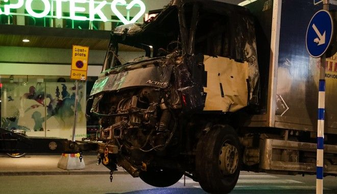 A destroyed truck is pulled away by a service car after it was driven into a department store in Stockholm, Sweden, Saturday, April 8, 2017. The hijacked beer truck plowed into pedestrians at the central Stockholm department store on Friday, sending screaming shoppers fleeing in panic in what Sweden's prime minister called a terrorist attack. (AP Photo/Markus Schreiber)