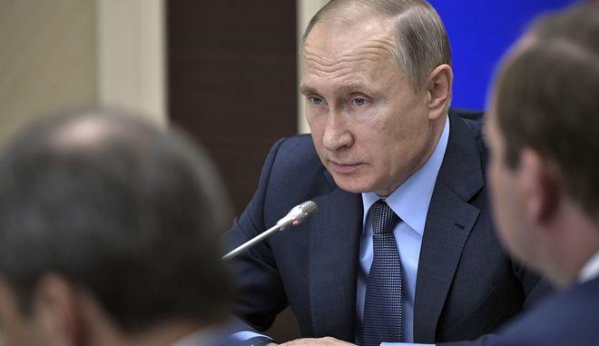 Russian President Vladimir Putin chairs a meeting at the Novo-Ogaryovo residence outside Moscow, Russia, Friday, July 28, 2017. (Alexei Nikolsky, Sputnik, Kremlin Pool Photo via AP)