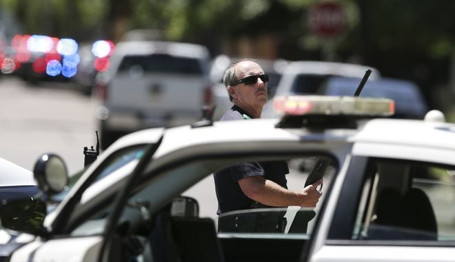 Dallas Police guard an area of a neighborhood where a shooting took place in east Dallas, Monday, May 1, 2017. Authorities said a Dallas paramedic has been shot while responding to a shooting call. (AP Photo/LM Otero)