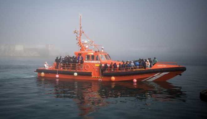 Migrants arrive on board a Spain's maritime rescue boat at the port of Tarifa, southern Spain, after being rescued in the Strait of Gibraltar, Wednesday, Aug. 16, 2017. Spain's maritime rescue service has saved more than 600 migrants trying to cross the Mediterranean Sea from Morocco in the past 24 hours, making it one of its busiest days so far this year. (AP Photo/ Marcos Moreno)