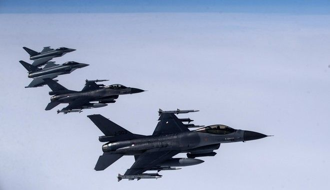 Royal Netherlands Air Force F- 16 military fighter jets, left, and German Eurofighter Typhoon fighter jets participating in NATO's Baltic Air Policing Mission operates in Lithuanian airspace during a Ramstein Alloy air force exercise, Tuesday, April 25, 2017. (AP Photo/Mindaugas Kulbis)