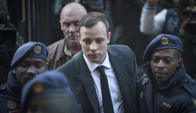 FILE - In this July 6, 2016, file photo, Oscar Pistorius, center, arrives at the High Court in Pretoria, South Africa, for a sentencing hearing for the murder of his girlfriend Reeva Steenkamp in his home on Valentine's Day 2013. South African prison officials said Sunday, Aug. 7, 2016, Pistorius was treated for injuries at a private hospital and has returned to a jail where he is serving a six-year sentence. (AP Photo/Shiraaz Mohamed, File)
